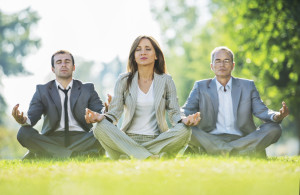Three business people sitting in lotus position outdoors.  [url=http://www.istockphoto.com/search/lightbox/9786622][img]http://dl.dropbox.com/u/40117171/business.jpg[/img][/url]